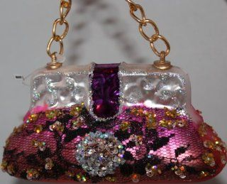 December Diamonds Fun Pink Blown Glass Purse Ornament Hanging from Gold Link Chain.Perfect Ornament for the Woman in Your Life who loves Purses.Fun Hand Blown Glass Ornament has been Discontinued.Approximately 2 1/2 inches Tall. Front of the Ornament has B