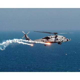 A U.S. Navy HH 60H Seahawk Helicopter dispenses flares and chaff Poster Print (31 x 25)