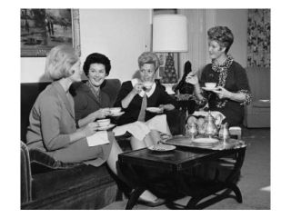 Four young women sitting together drinking tea Poster Print (18 x 24)